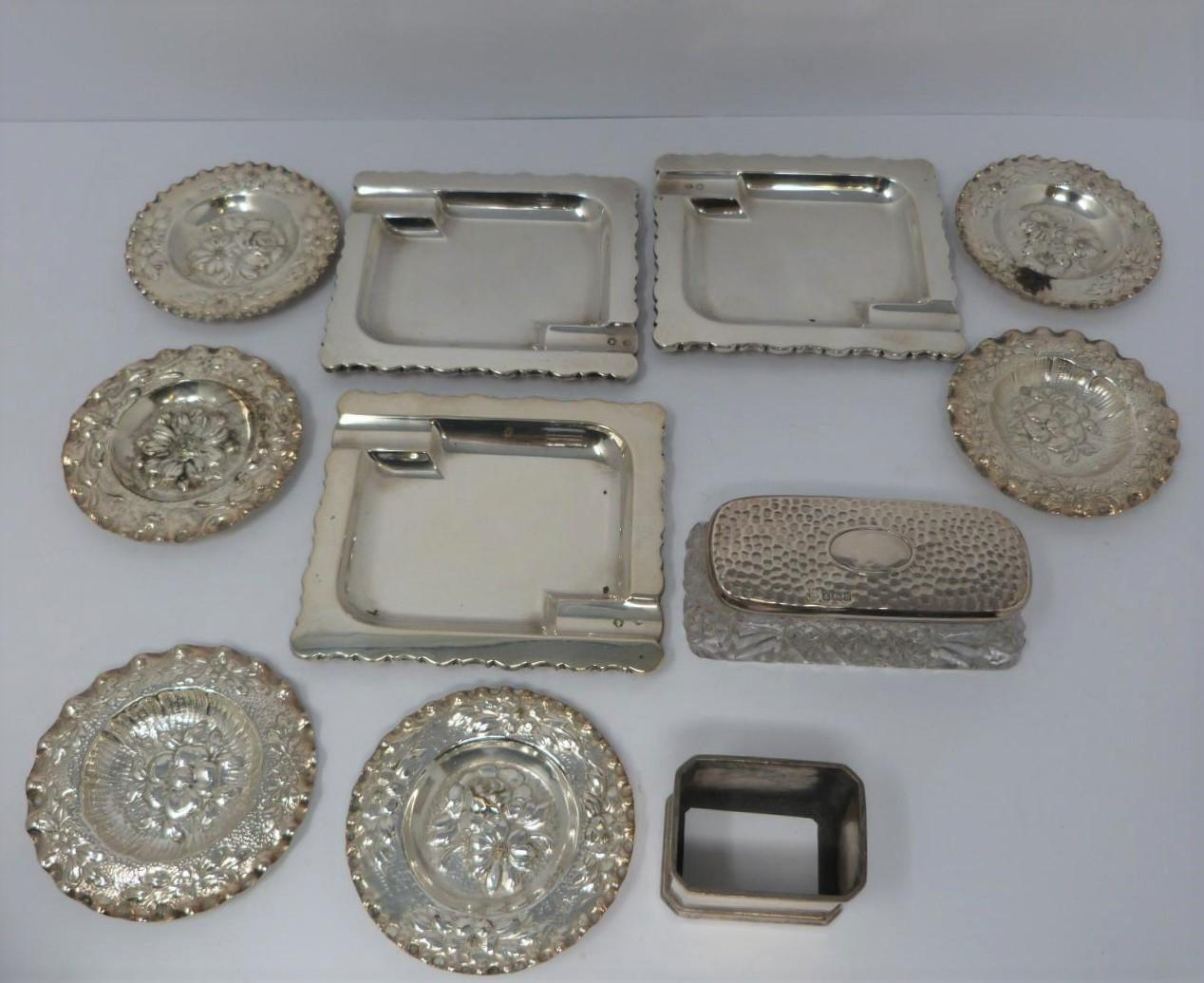 Three silver ash trays, a silver lidded box, silver salt and silver plated floral dishes, box: