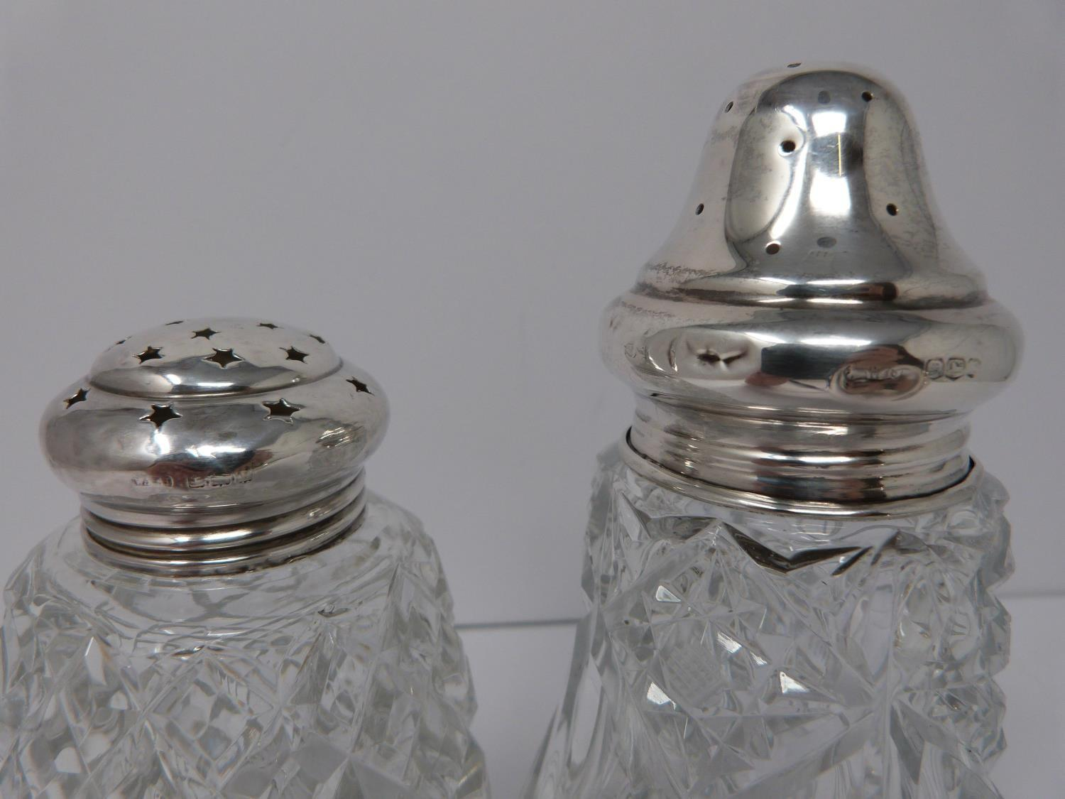 Two silver and cut glass sugar sifters, two silver pierced dishes and a silver engraved napkin ring, - Image 3 of 7