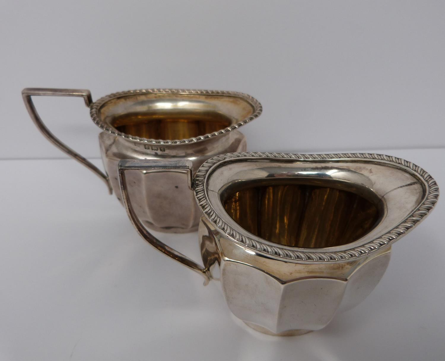 A silver six piece tea service with ebony handles and finial, coffee pot, tea pots, water jug, two - Image 6 of 10
