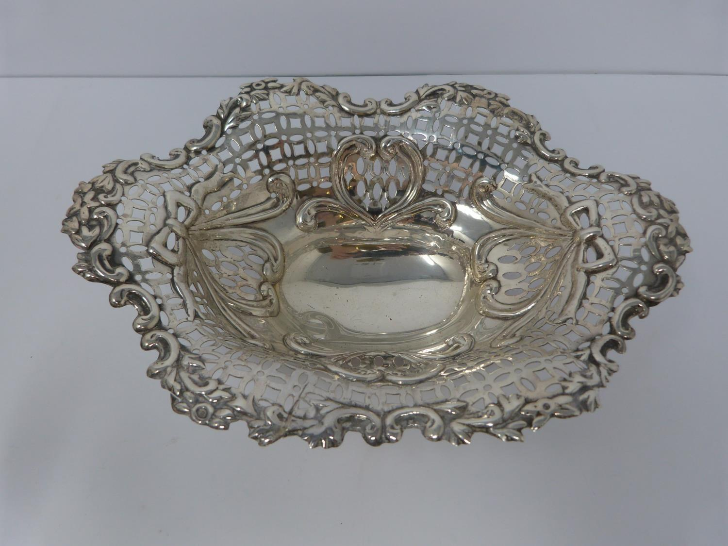 A collection of silver and white metal items including, trays and dishes, two pierced dishes one - Image 2 of 13