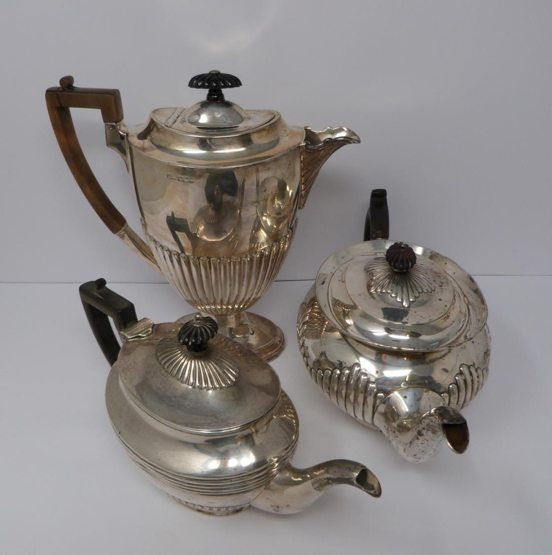 Two Victorian silver tea pots and a silver water jug, Sheffield, London and Sheffield, 1903,