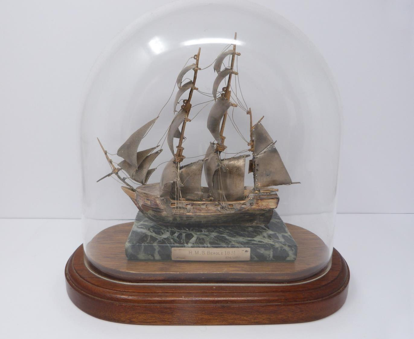 A silver model of the HMS Beagle 1831 in presentation case, 574/1000, mounted on alabaster base, A