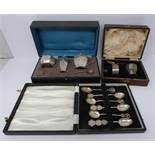 Hong silver spoons in box, cased silver christening set and cased silver cruet set, spoons having