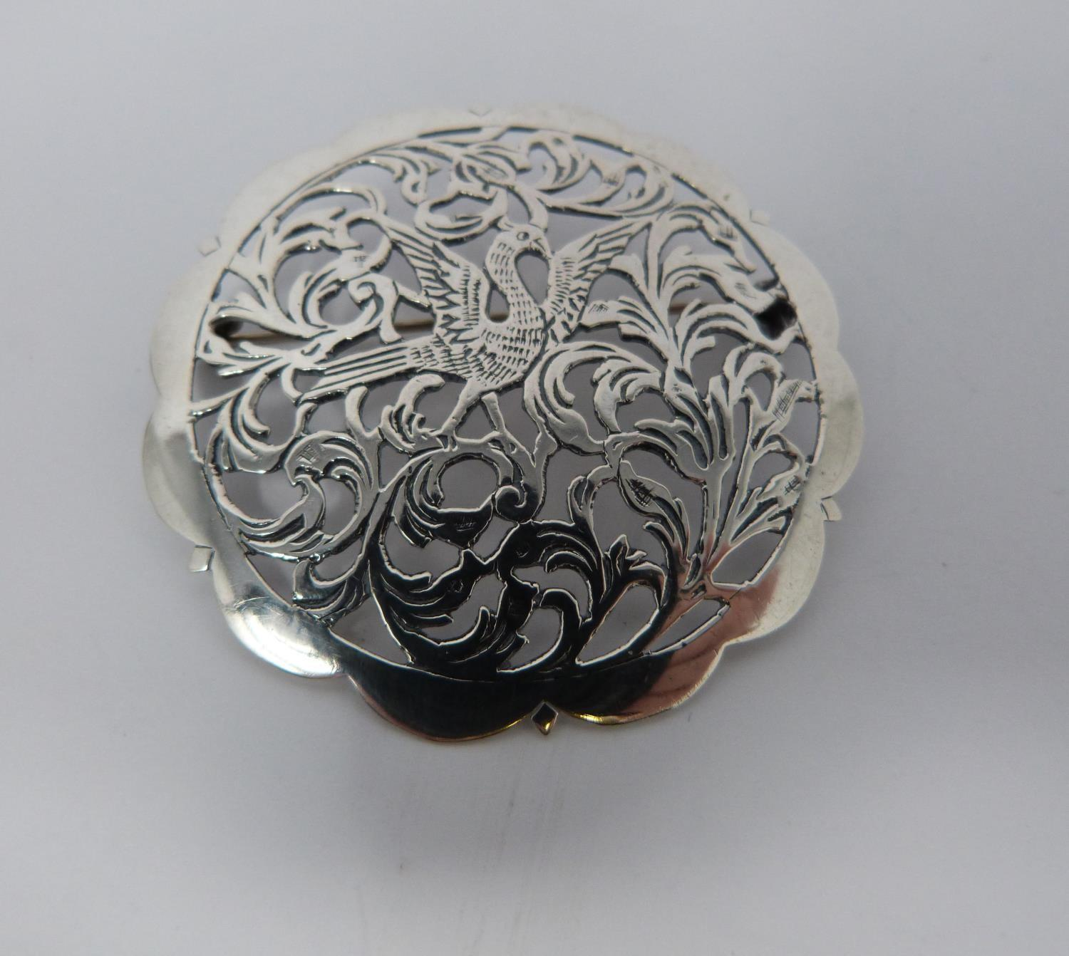Large jet and hallmarked silver pierced brooch, with a pierced white metal brooch, small silver - Image 4 of 7