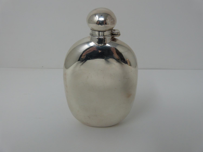 A Silver Harrods hip flask, Sheffield 1991, swilvel lock top. (171g).