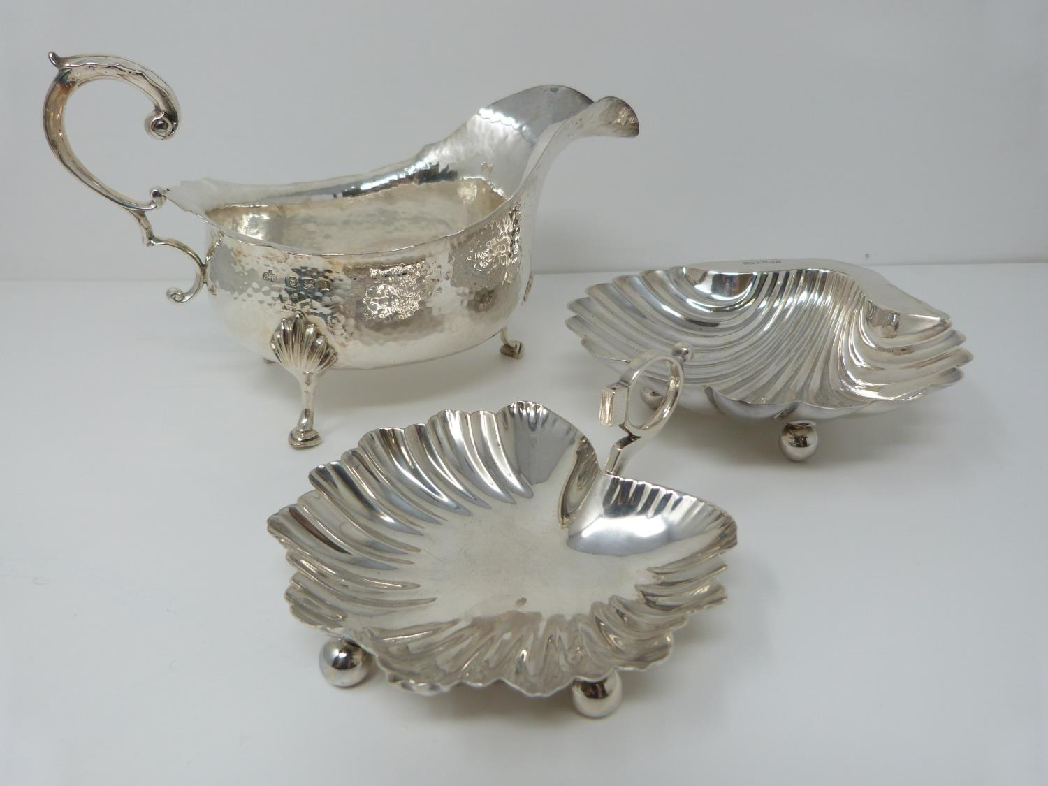 A silver sauce boat, Birmingham, Elkington and Co, 1908, a small handled shell dish, Sheffield,