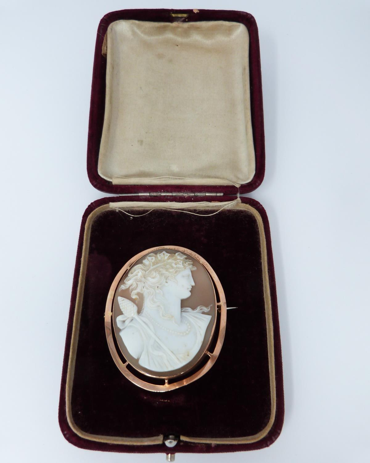 A 9ct Rose gold shell cameo of Dionysis side profile, makers mark AW, 9ct gold mark, he is