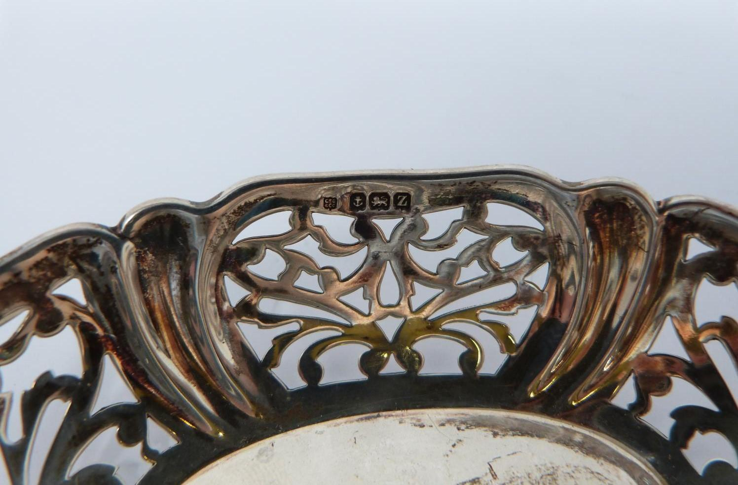A collection of silver and white metal items including, trays and dishes, two pierced dishes one - Image 7 of 13