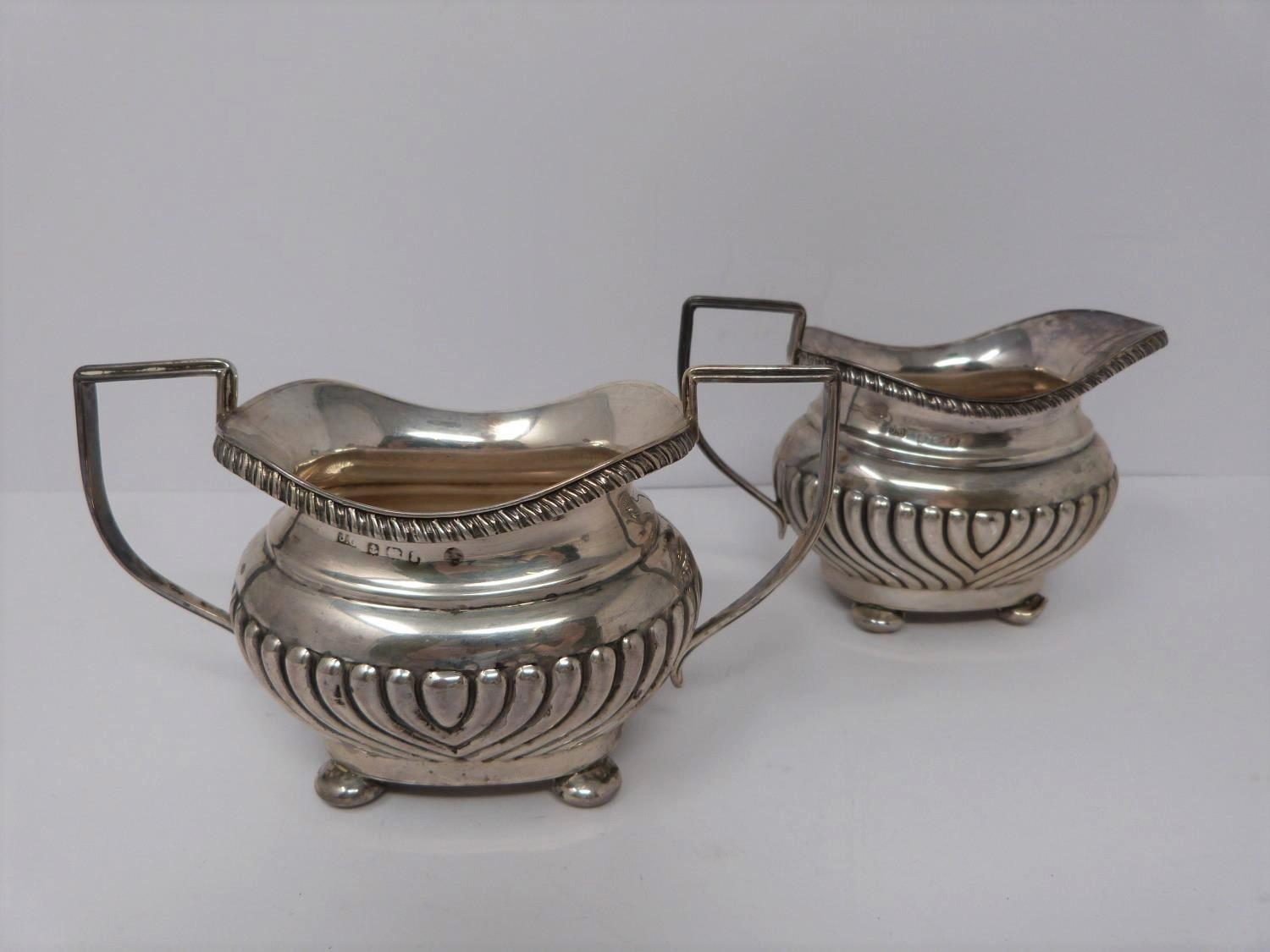 Two silver jugs, sugar and repousse work bowl. Bowl on three lions feet, 1857, London, Henry - Image 2 of 9
