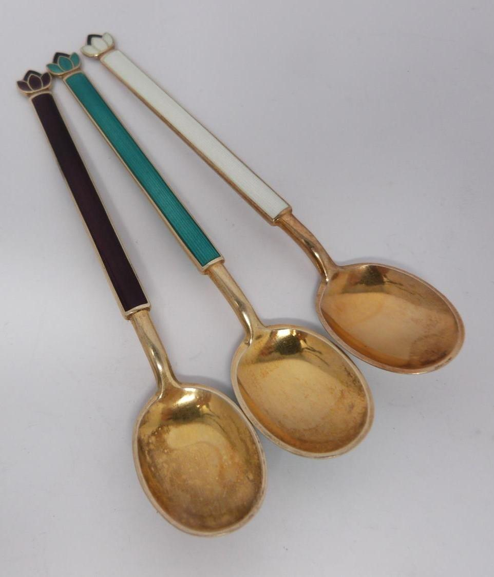 A collection of silver and enamel spoons, Norwegian and English, three spoons in a case, - Image 12 of 17