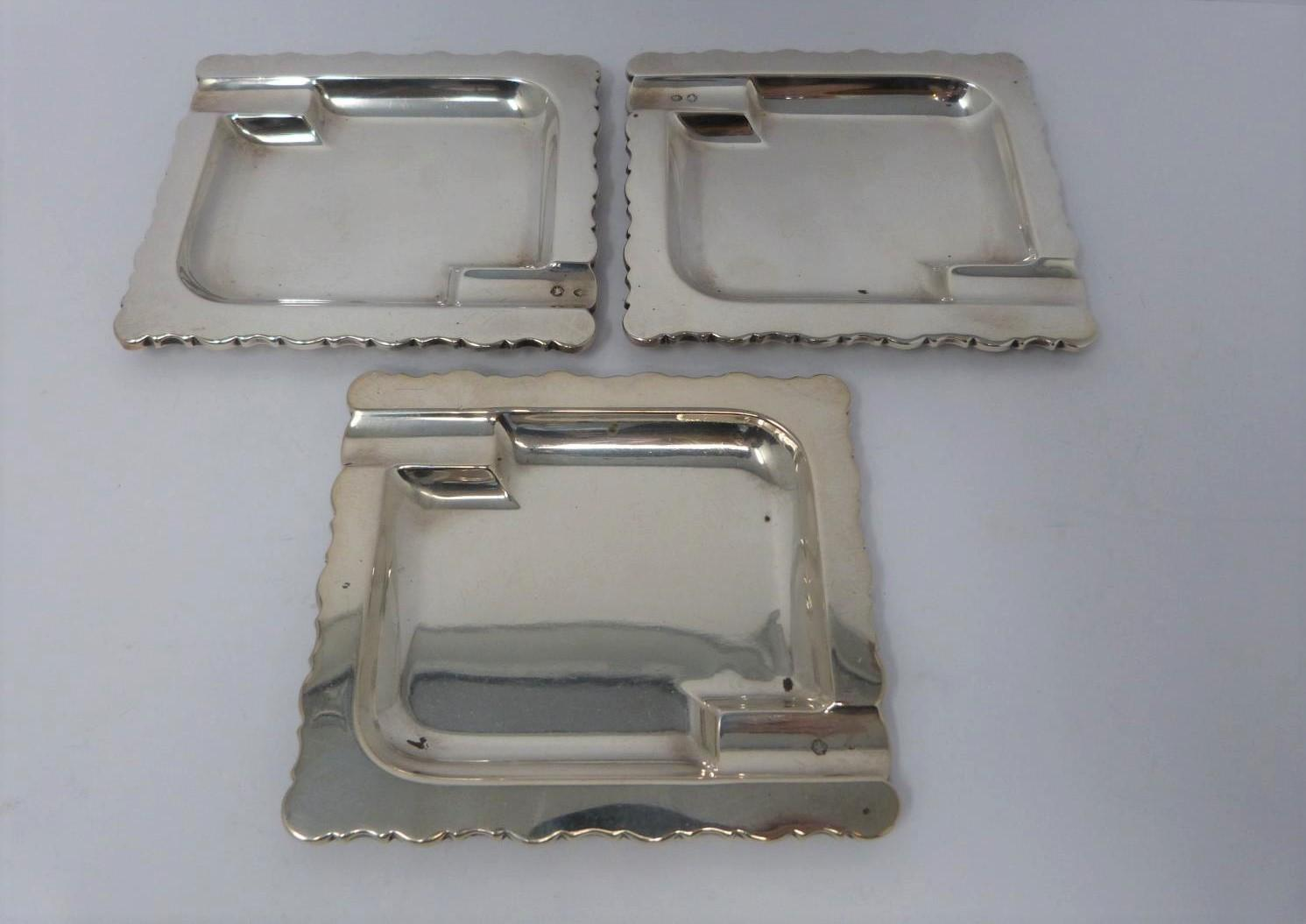 Three silver ash trays, a silver lidded box, silver salt and silver plated floral dishes, box: - Image 3 of 7