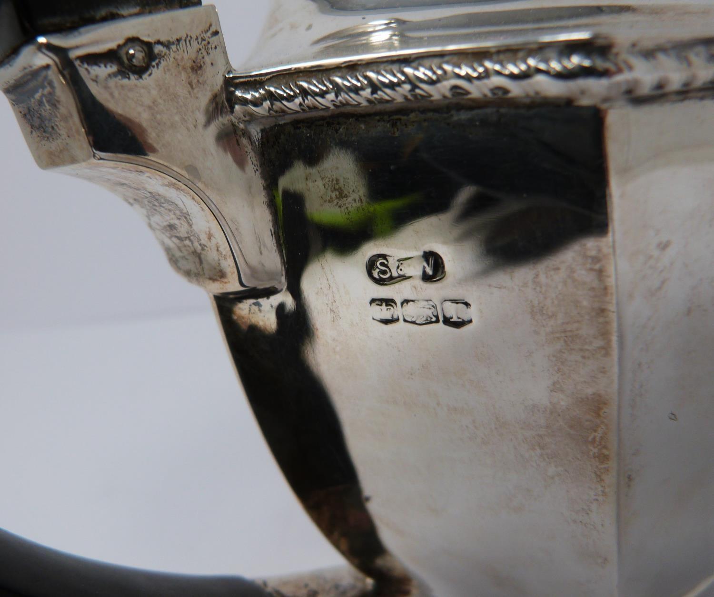 A 3 piece silver service; coffee pot, water jug and large tea pot, coffee pots William Devenport, - Image 10 of 11