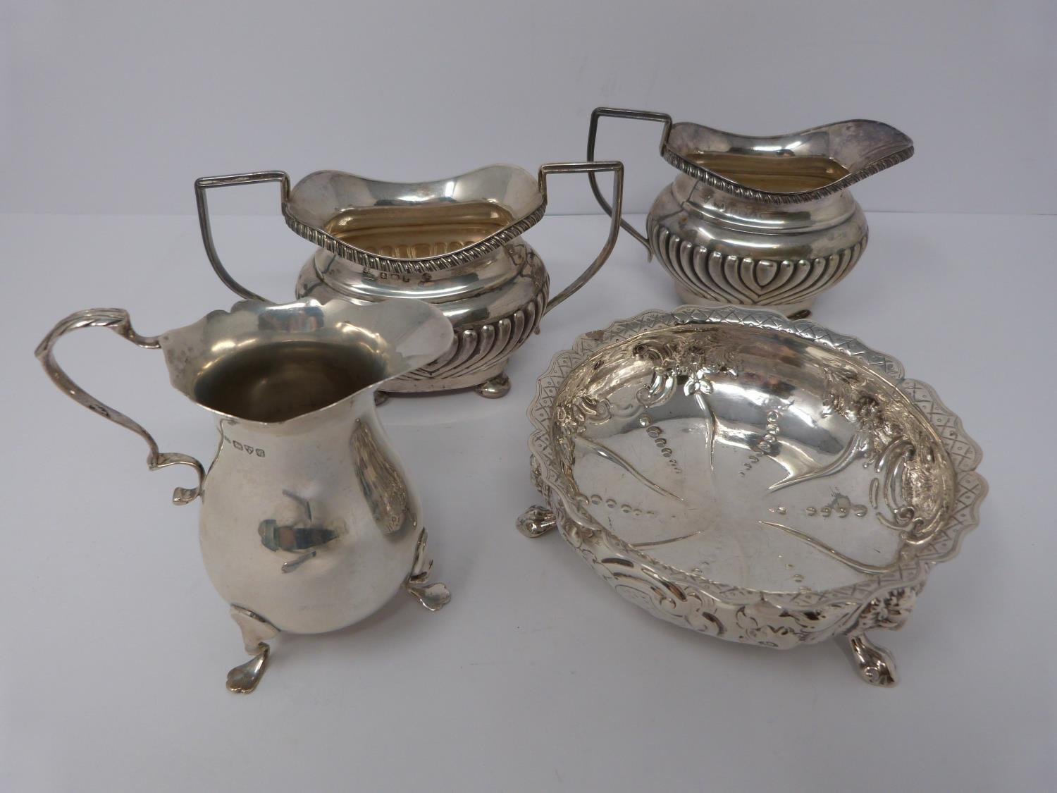 Two silver jugs, sugar and repousse work bowl. Bowl on three lions feet, 1857, London, Henry