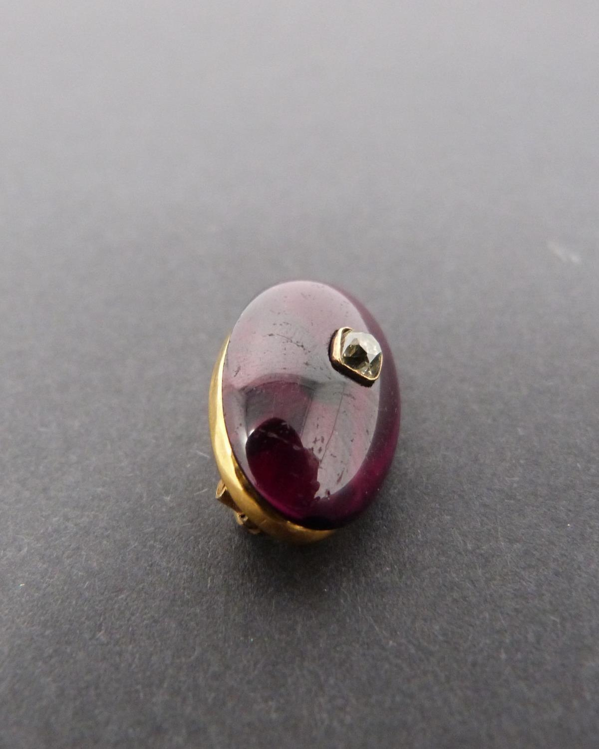 A Georgian/Victorian yellow metal oval garnet brooch inset with diamond, hollow foil backed cabochon - Image 4 of 6