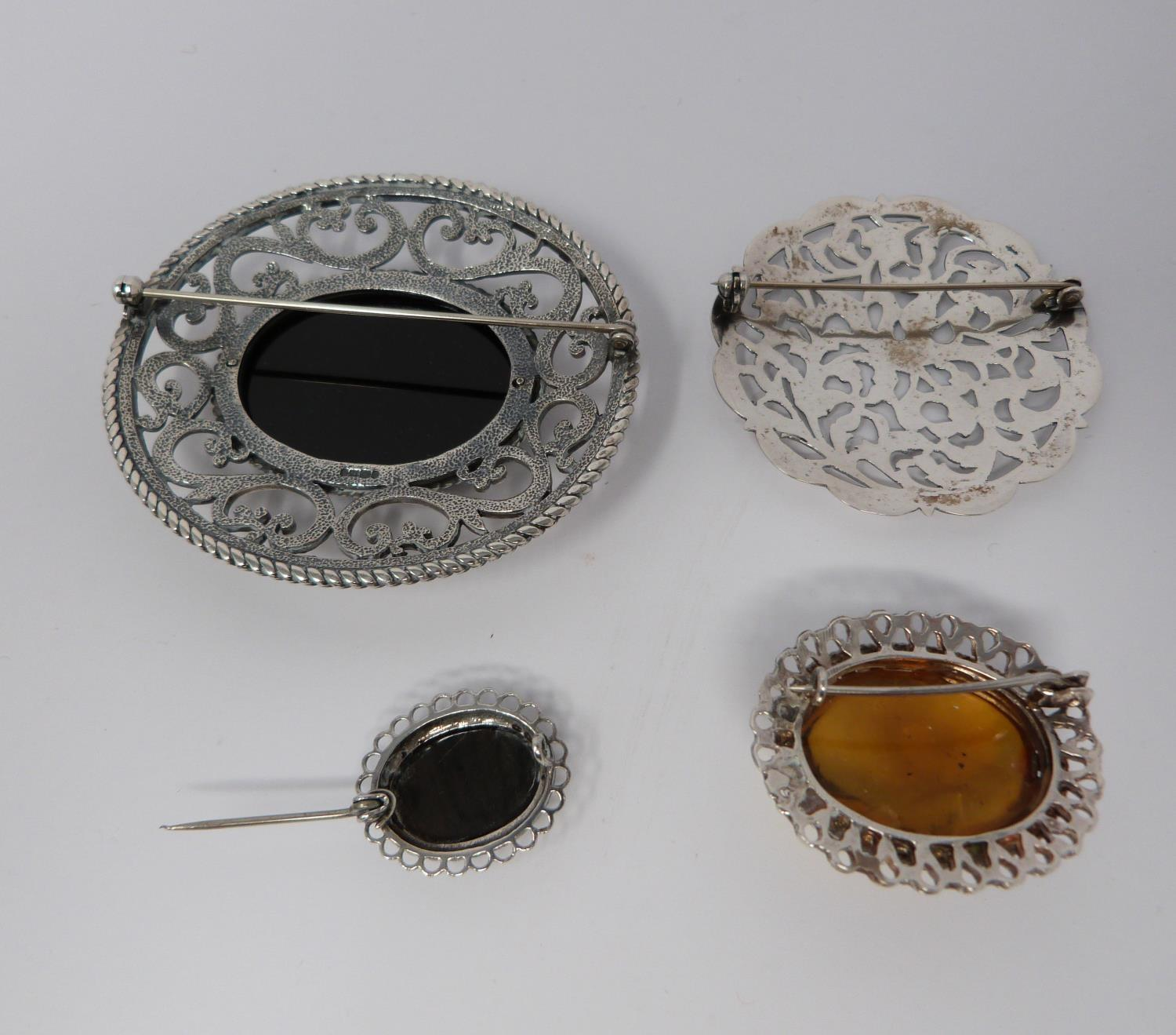 Large jet and hallmarked silver pierced brooch, with a pierced white metal brooch, small silver - Image 2 of 7