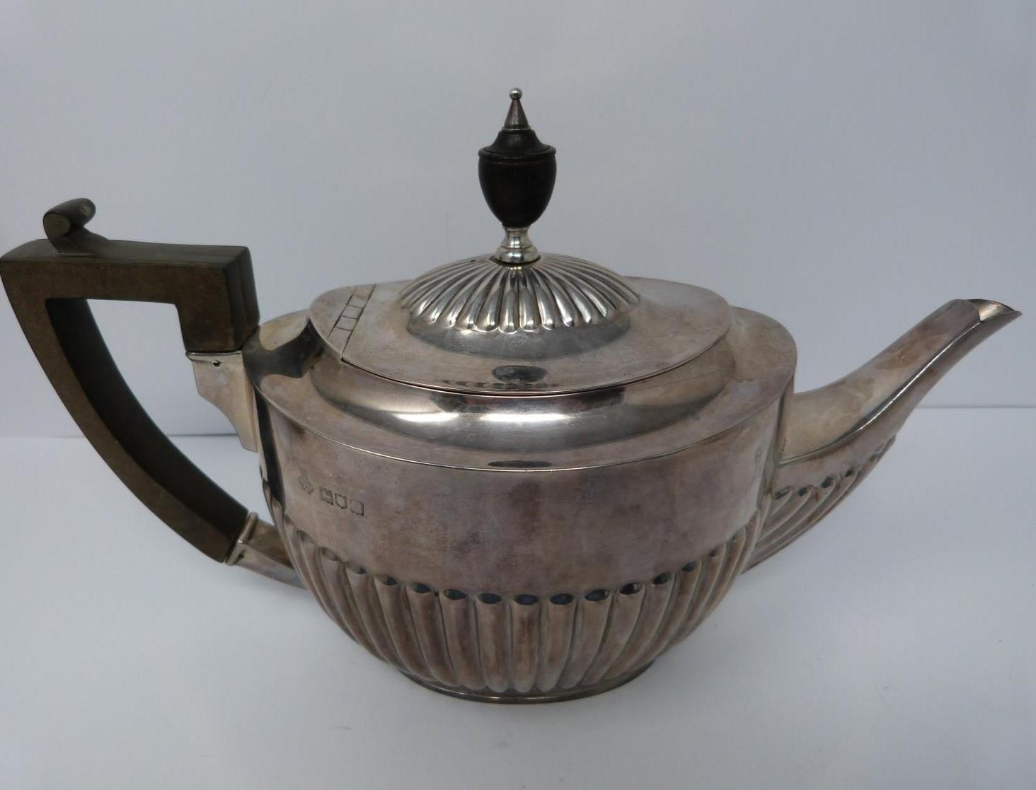 A three piece silver tea set, sugar, tea pot and milk jug, tea pot and helmet jug Ebony handle by - Image 2 of 10