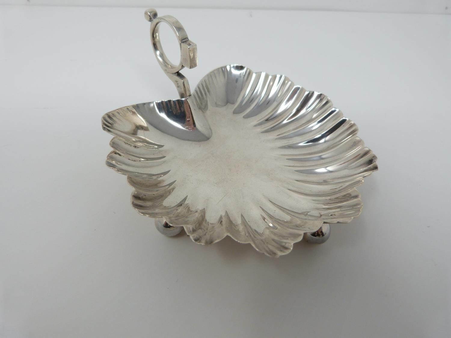 A silver sauce boat, Birmingham, Elkington and Co, 1908, a small handled shell dish, Sheffield, - Image 8 of 10