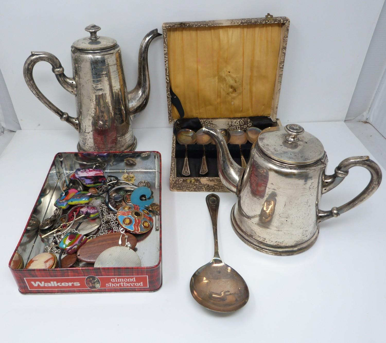A collection of costume jewellery, silver plate tea service and silver plated cased spoons, service: