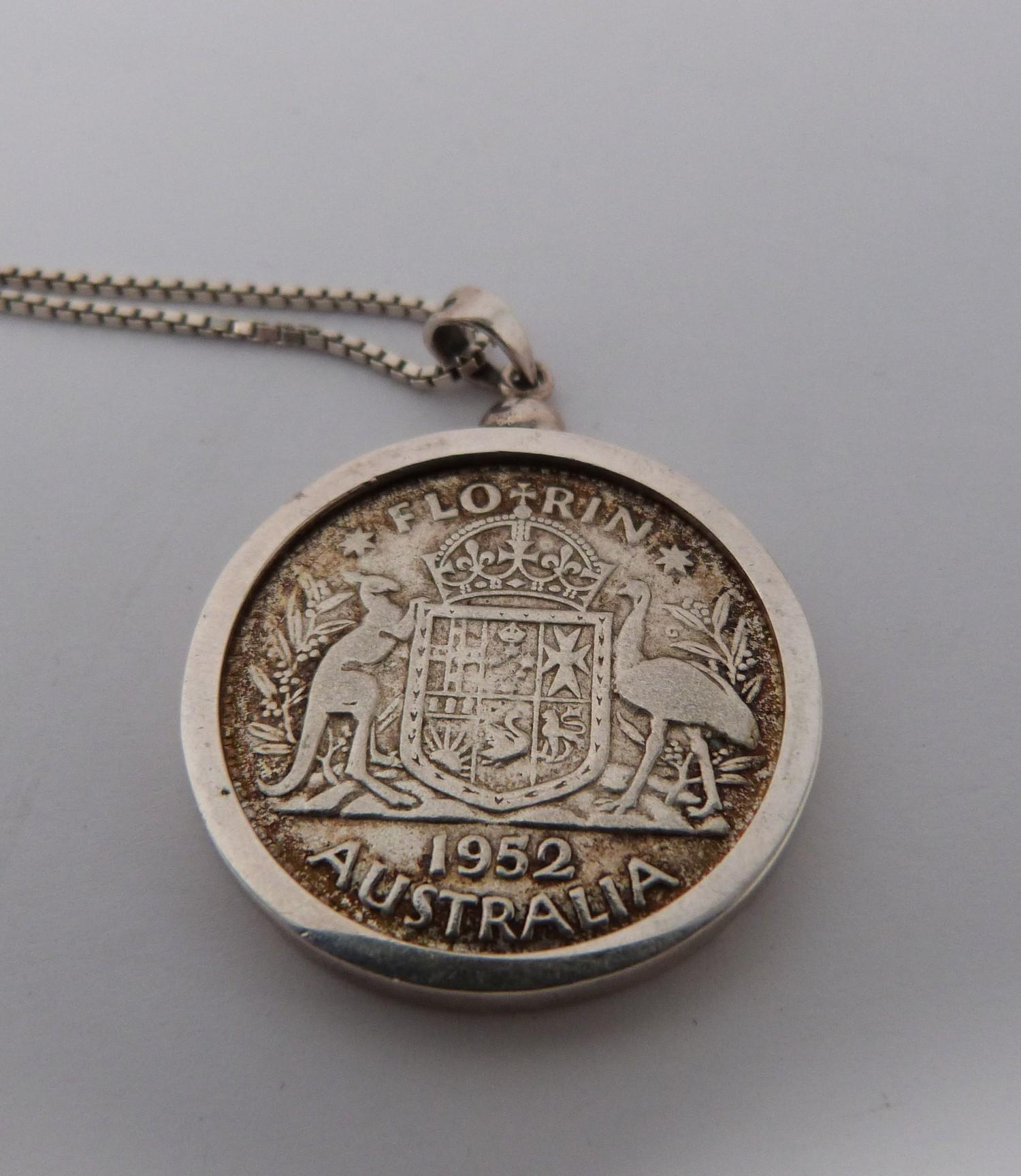 Two silver coins in silver and white metal mounts on silver chains, an American one dollar coin, - Image 4 of 6