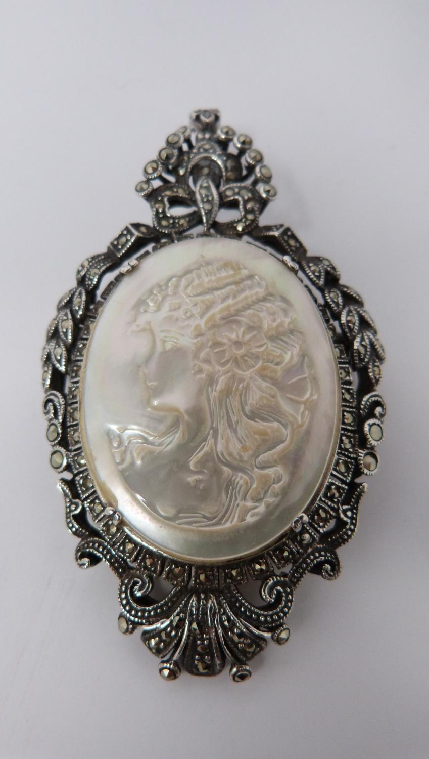A silver mother of pearl cameo brooch/pendant with Marcasite stones with four other vintage - Image 2 of 6