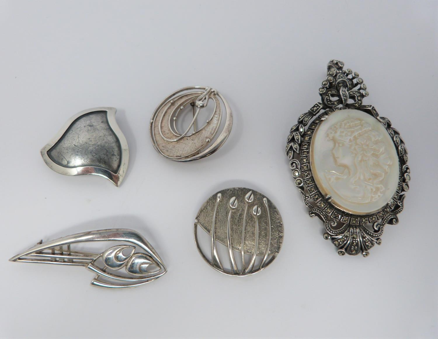 A silver mother of pearl cameo brooch/pendant with Marcasite stones with four other vintage