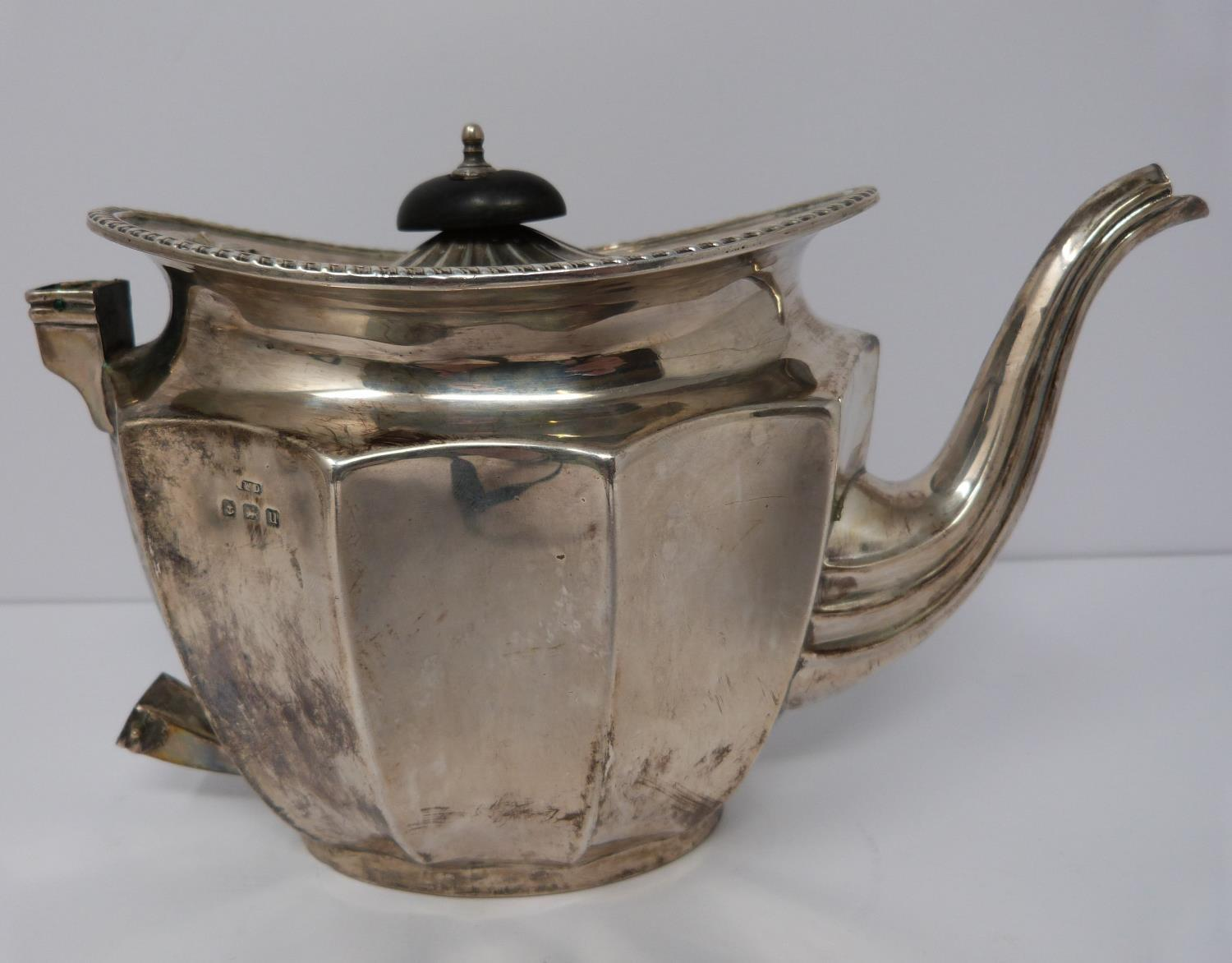 A silver six piece tea service with ebony handles and finial, coffee pot, tea pots, water jug, two - Image 8 of 10