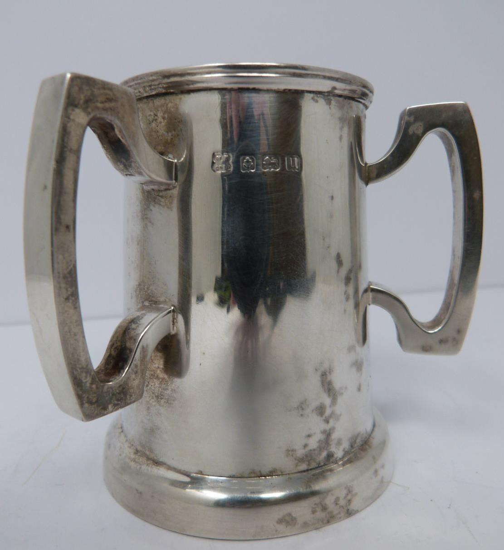 A three handled silver tyg/loving cup, Birmingham, 1919 by Martin Hall & Co Ltd. (119g). - Image 2 of 5