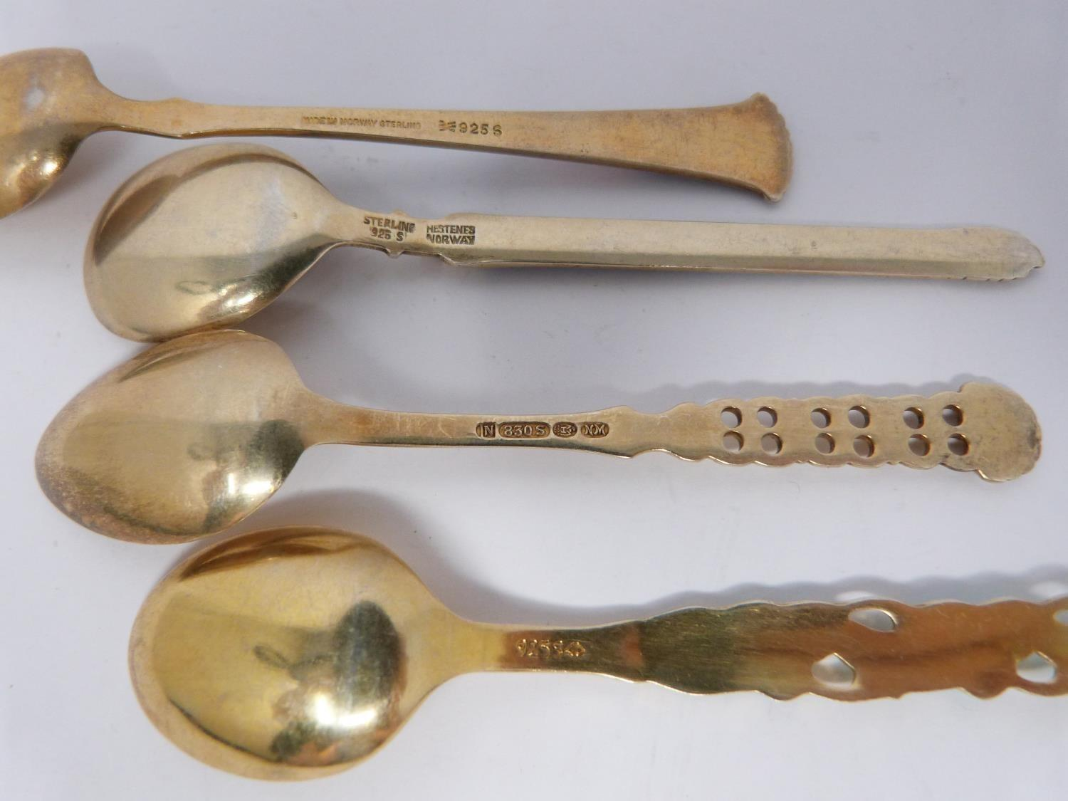 A collection of silver and enamel spoons, Norwegian and English, three spoons in a case, - Image 9 of 17