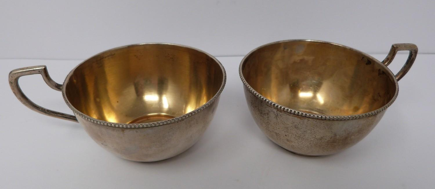 A pair of gilded silver Austrian punch cups, 1872, A city mark, makers mark JR. (169g).