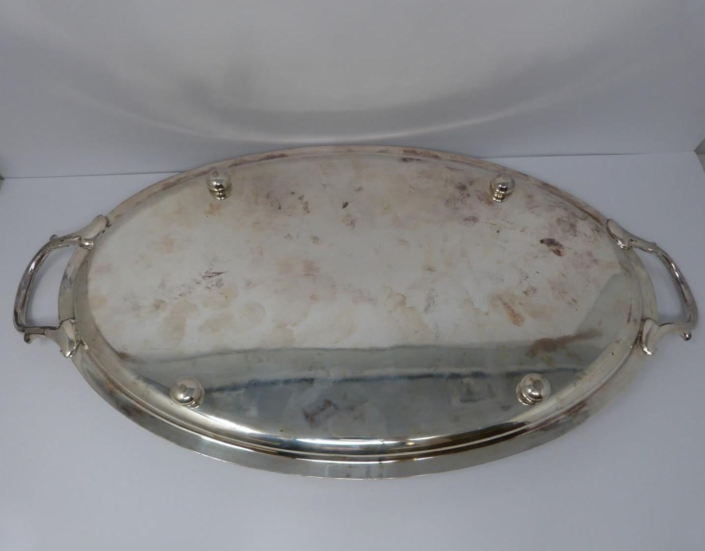 A large silver oval tray, monogrammed with H, round pebble feet, foliate design handles, ridged rim, - Image 2 of 5