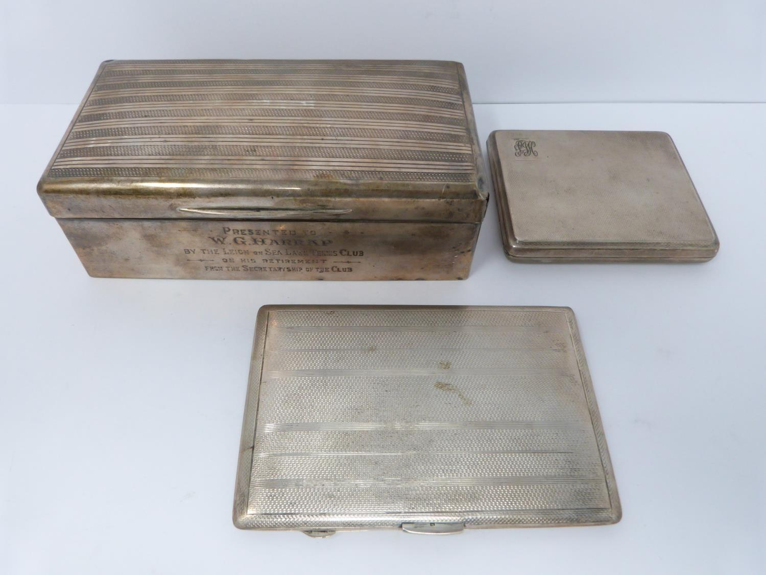 Two silver cigarette cases and a silver cigarette box, rectangular engine turned decoration case,