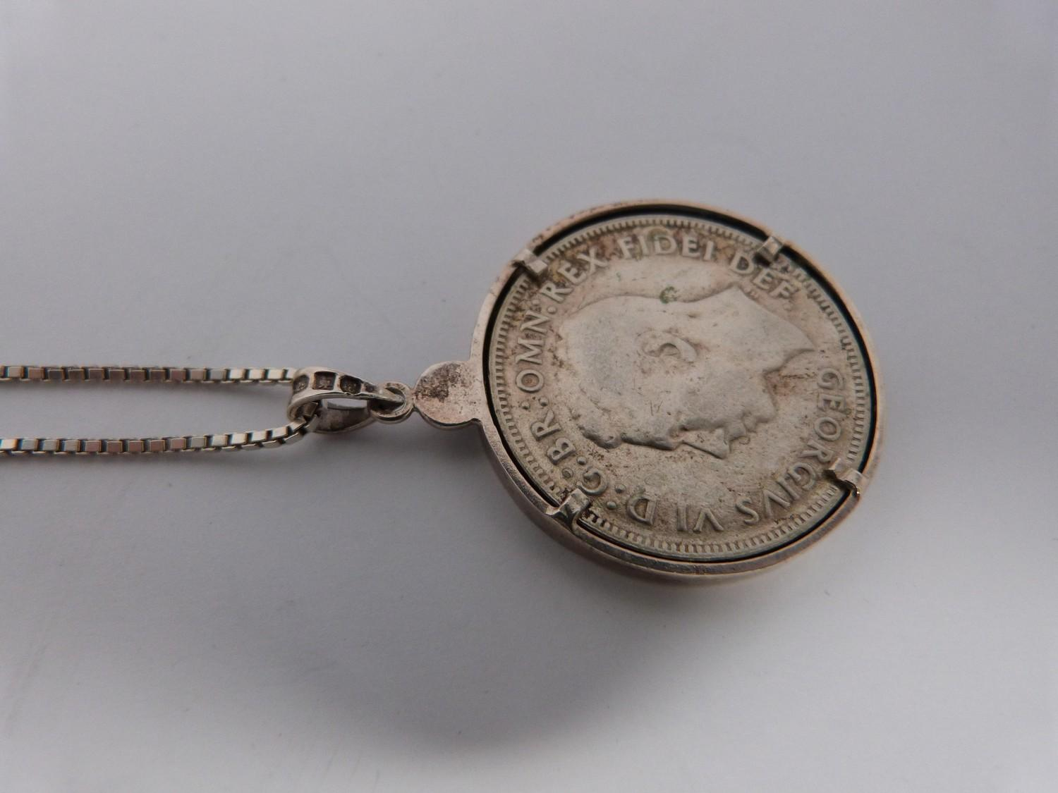 Two silver coins in silver and white metal mounts on silver chains, an American one dollar coin, - Image 6 of 6