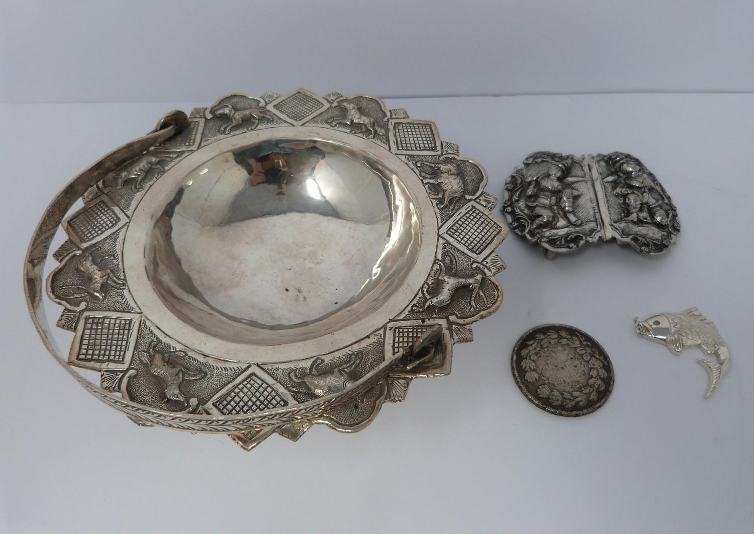A white metal oriental handled dish, coin, silver fish pendant and white metal thai buckle, basket