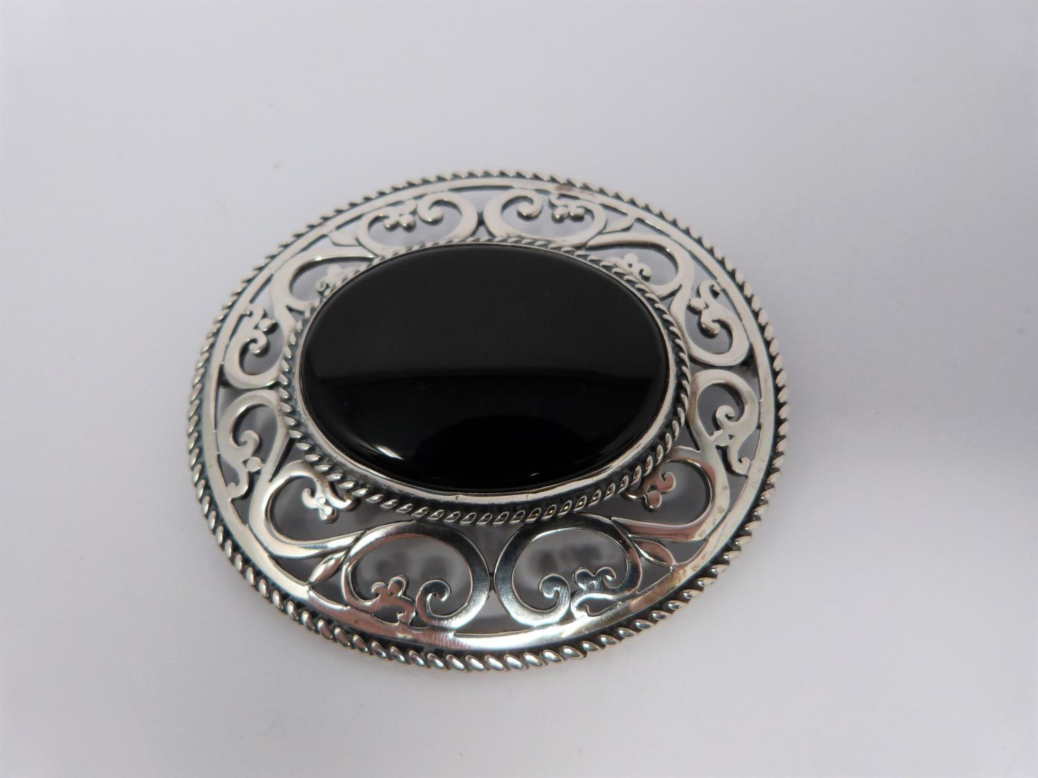 Large jet and hallmarked silver pierced brooch, with a pierced white metal brooch, small silver - Image 3 of 7