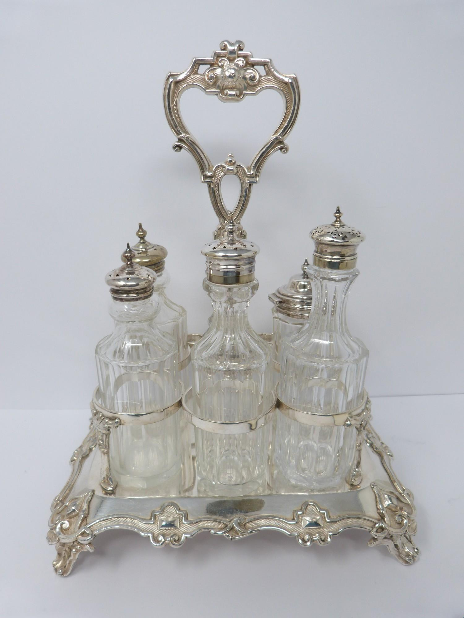 Victorian heavy Sheffield plate and silver plate cut glass cruet set, highly decorated borders,