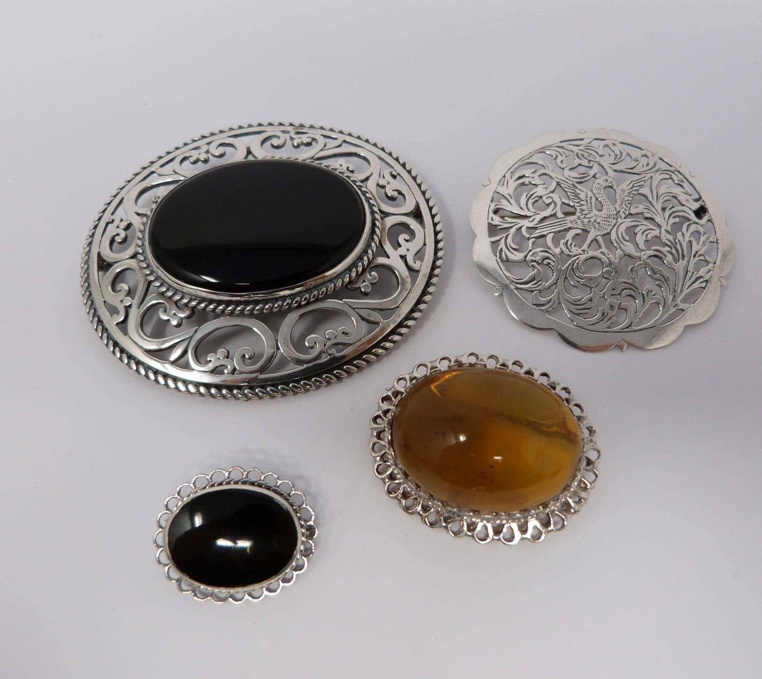 Large jet and hallmarked silver pierced brooch, with a pierced white metal brooch, small silver