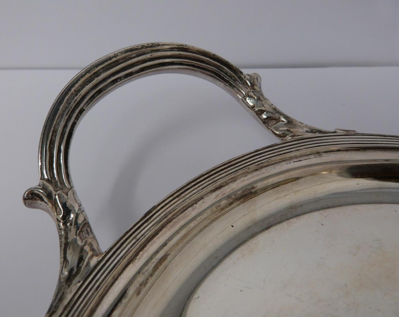 A large silver oval tray, monogrammed with H, round pebble feet, foliate design handles, ridged rim, - Image 5 of 5