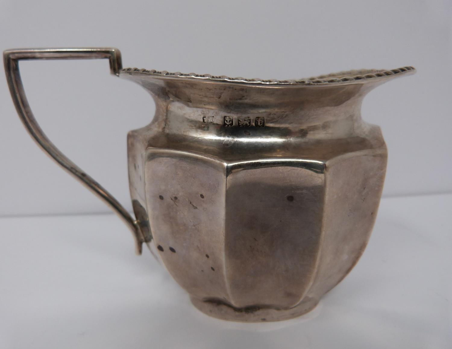 A silver six piece tea service with ebony handles and finial, coffee pot, tea pots, water jug, two - Image 5 of 10
