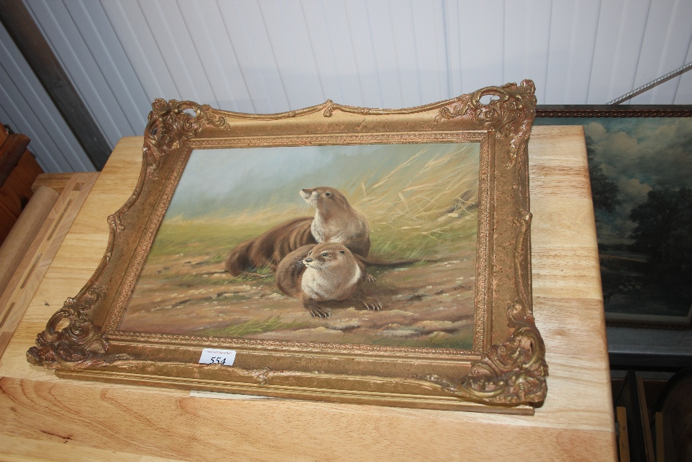 Lot 554 - A gilt framed oil on board study depicting otters
