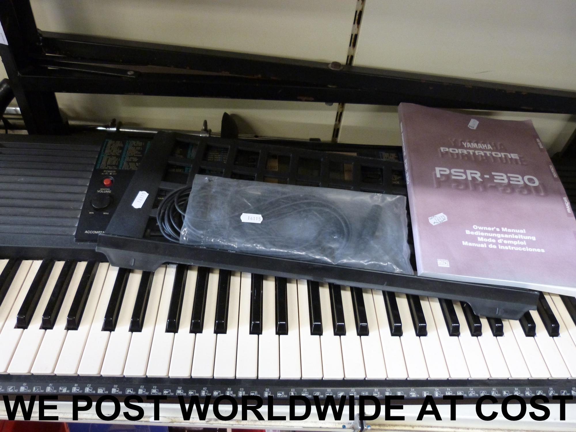 Lot 403 - A Yamaha PSR 330 together with instructi