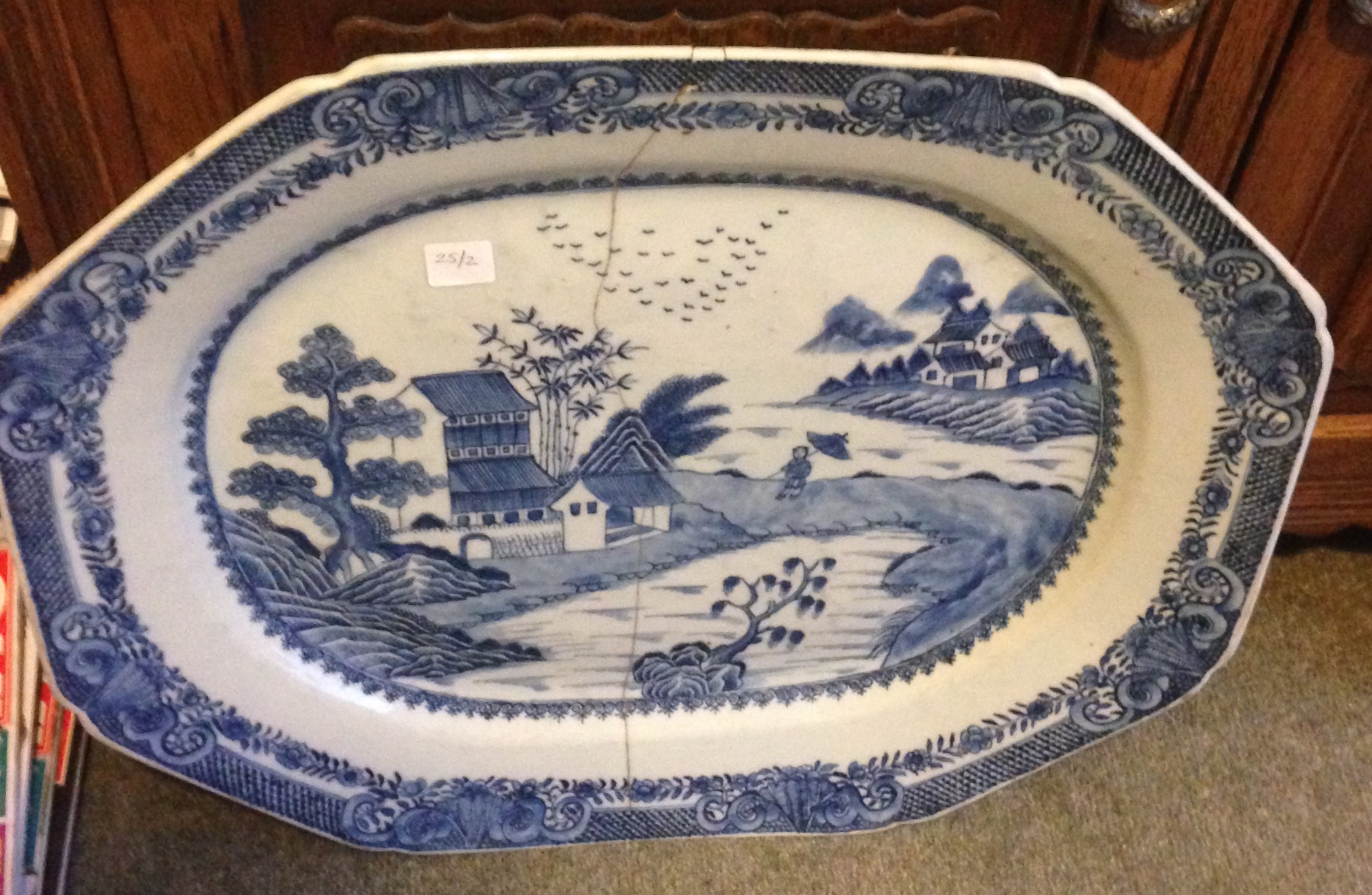 Lot 17 - An 18th c blue and white porcelain platter a/f