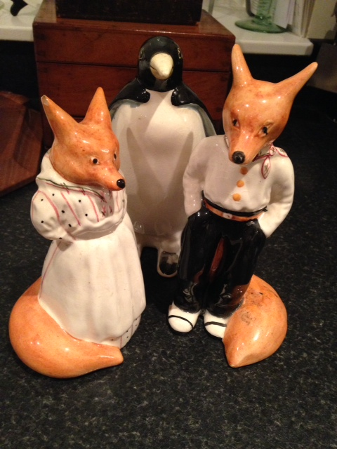 Lot 31 - Three pcs, Garden House pottery , 2 foxes and a penguin