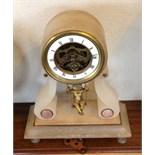 A 19th c swinging cherub mantle clock