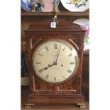 Good Regency mahogany bracket clock with pineapple finial the twin fusee movement striking on a bell