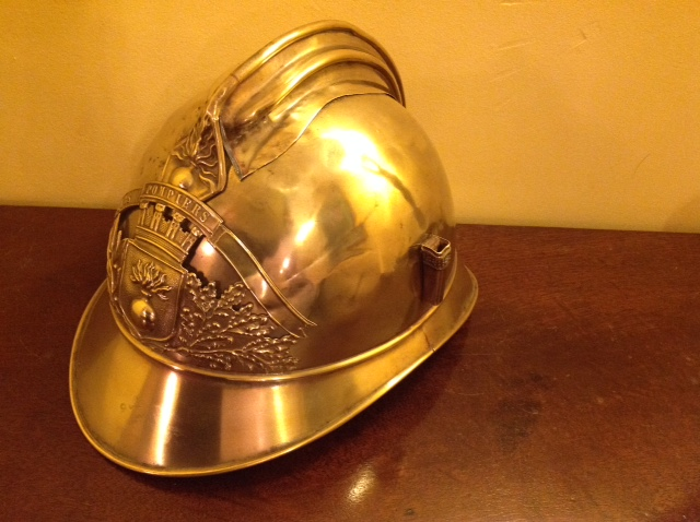 "Lot 47 - Early 20th c French fireman's helmet with plume holder to right ""Sapeur et Pompiers"""