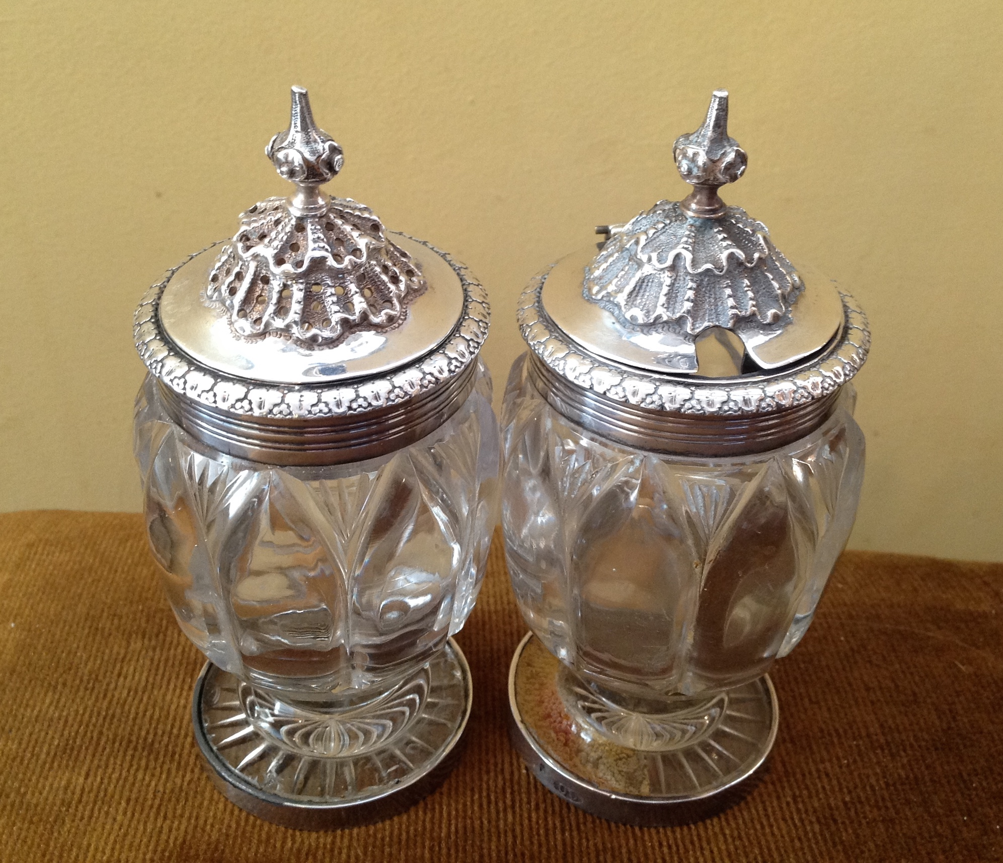 Lot 45 - Pair London 1827 silver mounted glass mustard and pepper pots with restoration