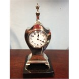 A small silver mantle clock B'ham 1921