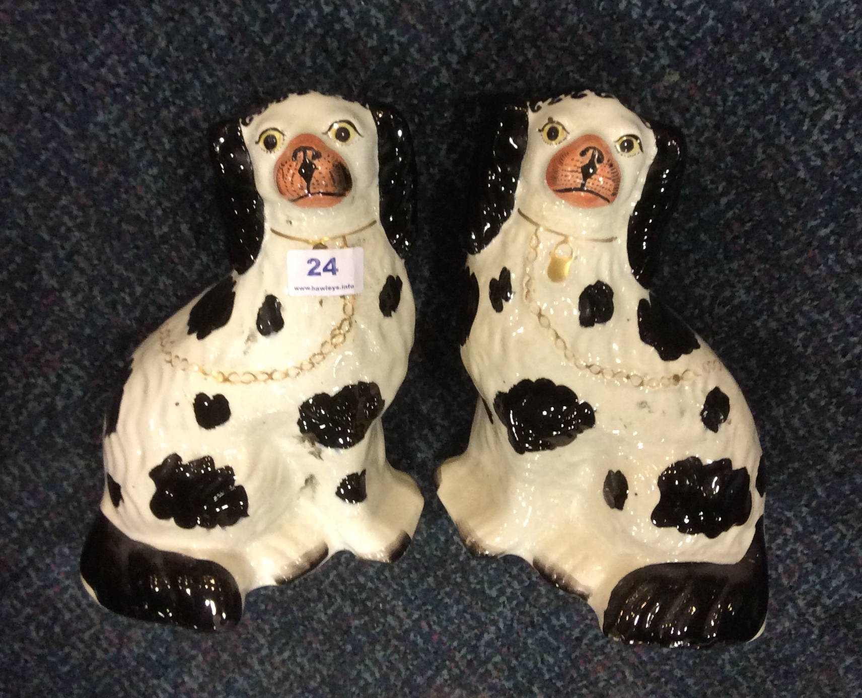 Lot 52 - Pair of Staffordshire dogs with Disraeli curls 16 cms high