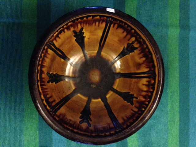 Lot 32 - Winchcombe Pottery slipware bowl by Michael Cardew marked to base MC & WP 27 cms diameter