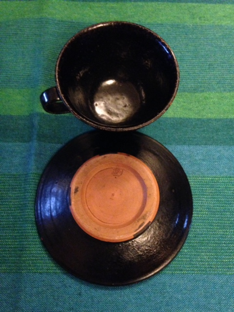 Lot 33 - Dartington Pottery black cup and saucer reputedly made by Bernard Leach when working at the